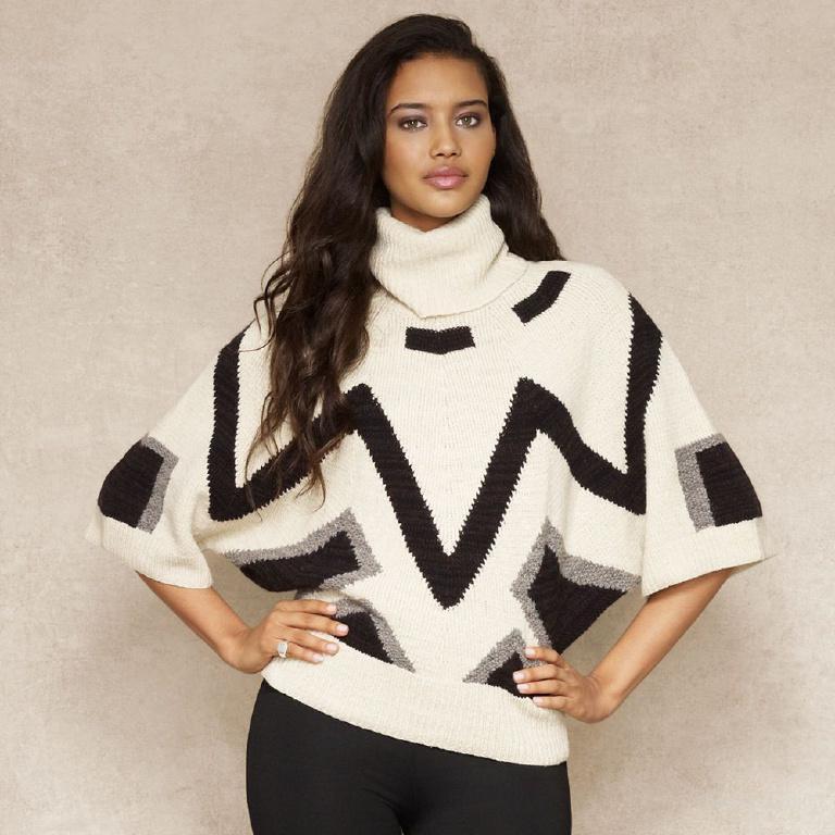Вязаный свитер с черно-белым жаккардом. продам. грн.  785.