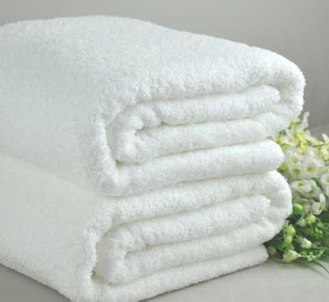 Махровые белые полотенца для отеля